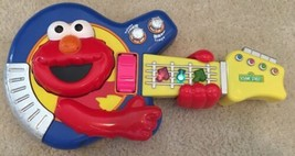 2002 Sesame Street Jam with Elmo Guitar, Fisher Price Lights Tempo Whoopie Bar - $13.85