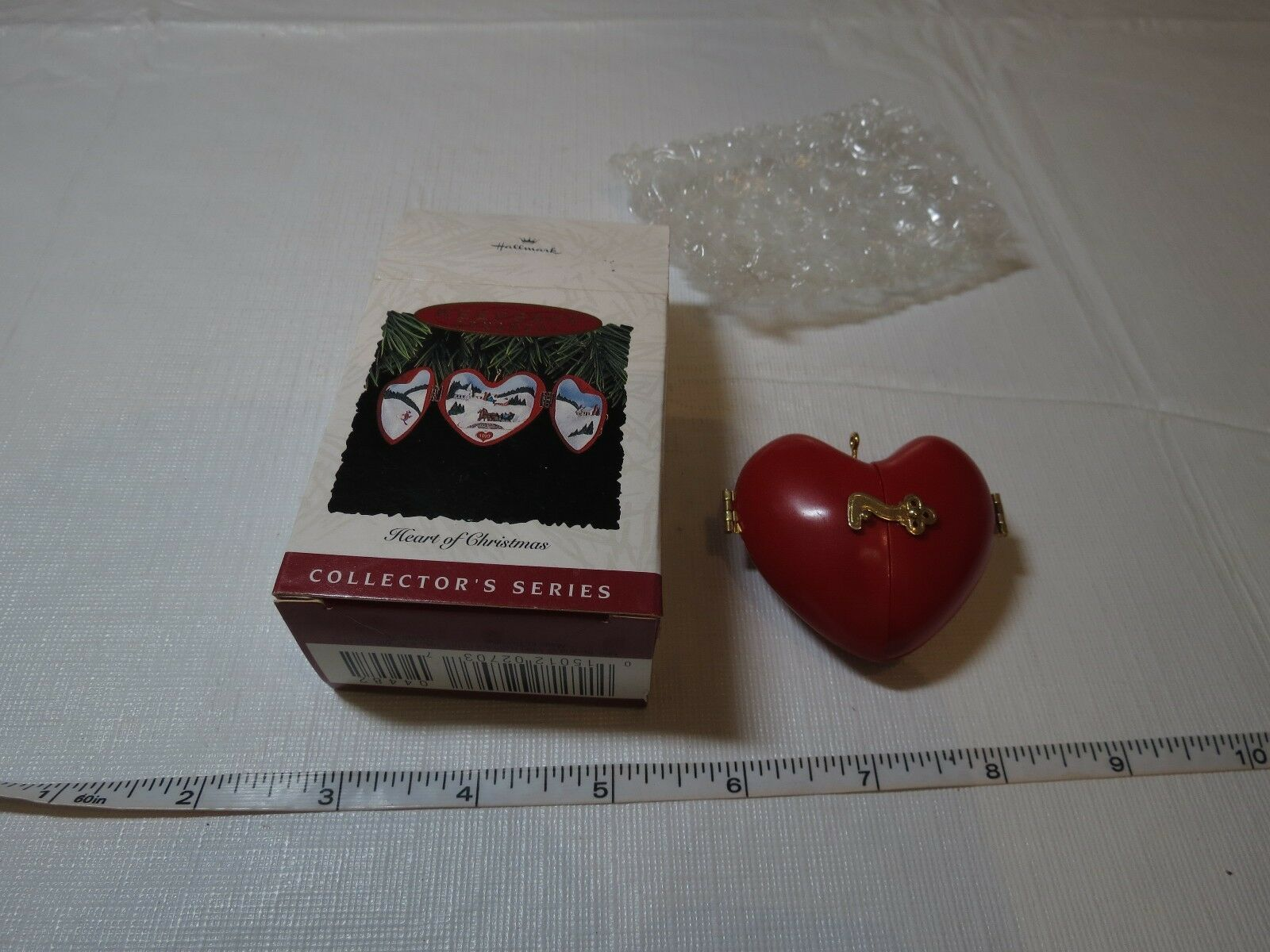 Red Heart of Hallmark Keepsake Ornament Christmas 1993 opens snow sled Church