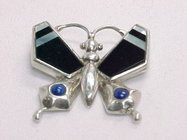 Butterfly Pendant In Sterling Silver With Lapis, Black Onyx, And Mother Of Pearl - $75.00