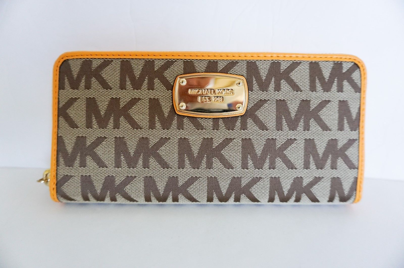 b663eac43cb2 57. 57. Previous. MICHAEL KORS JET SET ITEM ZIP AROUND CONTINENTAL WALLET  SIGNATURE BEIGE YELLOW · MICHAEL ...