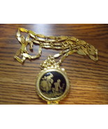Vintage Golden Locket and Chain with black and gold old world motif on f... - $28.00
