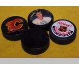 Hockey 4pucks thumb155 crop