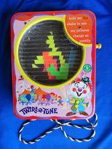 1965 Mattel Tin Toy Red Twirl-A-Tune Kaleidoscope Musical Hand Crank - $65.00