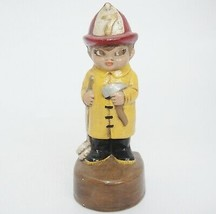 Vintage Ceramic Fireman Figurine Number 7 Yellow Coat Holding Hose and A... - $12.86