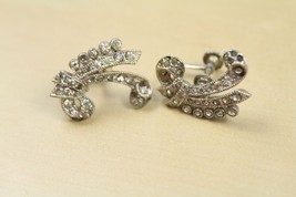 Vintage 60s Silver Tone Rhinestone Bow Curly Scroll Primitive Screw On E... - $14.84