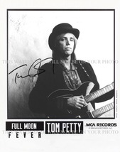 An item in the Entertainment Memorabilia category: TOM PETTY SIGNED AUTOGRAPHED AUTOGRAPH 8X10 RP PROMO PHOTO LEARNING TO FLY