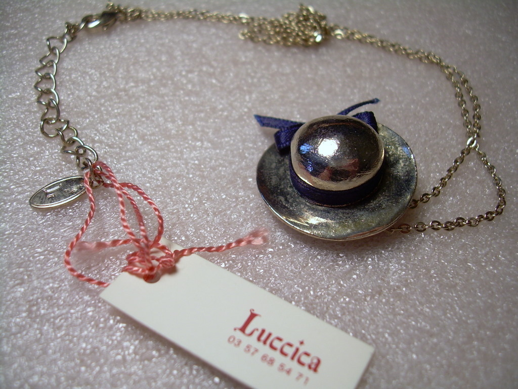Vintage silver hat with navy blue ribbon necklace New with Tag from Vintage shop