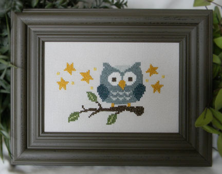 Blue owl on branch 2