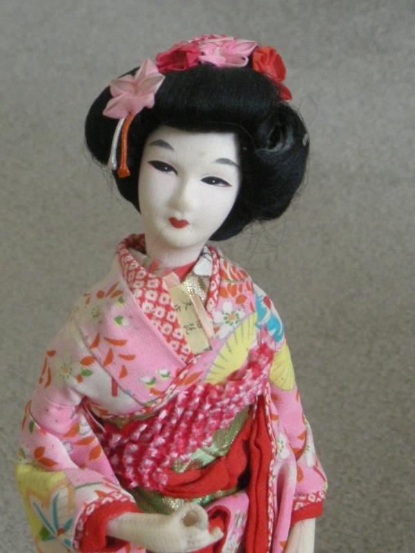 Vintage Geisha doll on stand