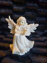 Angel Figurine  #82 - $3.00