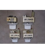 7EEE69 SET OF 4 BURNER CONTROLS FROM KENMORE 665.92012102 RANGE, SOLD AS IS - $29.47