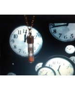 Haunted Time travel hourglass pendant~backward,forward,alter past - $100.00