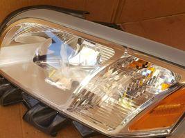 06-09 Mitsubishi Raider Headlight Head Light Lamp Driver Left LH image 3