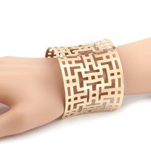 UNITED ELEGANCE Contemporary Rose Gold Tone Cuff Bracelet With Cut Out D... - $19.99