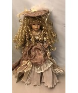 """The Emerald collection porcelain doll 16"""" Brown Eyes and Dress with Hat - $11.88"""