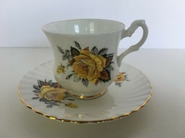 Rosina Tea Cup and Saucer Scalloped Yellow Roses Vintage High Handle Gol... - $18.69