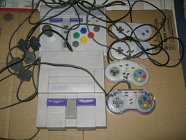 Super Nintendo Console with 5 games and 5 controllers Super Game Boy Ada... - $125.00