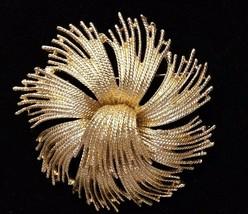 Vintage Monet Tassel Cordelia Gold Tone Swirl Firework Brooch Pin Signed - $29.69