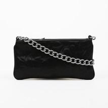 Chanel Black Satin Camellia Embossed Clutch - $16.962,91 MXN