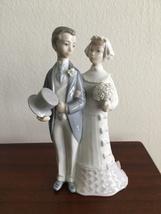 Vintage Lladro porcelain bride and groom figurine cake topper.  - $48.00