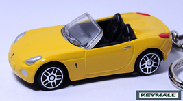 KEY CHAIN 07~2008~2009 YELLOW PONTIAC SOLSTICE/SKY CONVERTIBLE LLAVERO P... - $28.97