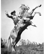 Roy Rogers riding Trigger and waving iconic pose 16x20 Poster - $19.99