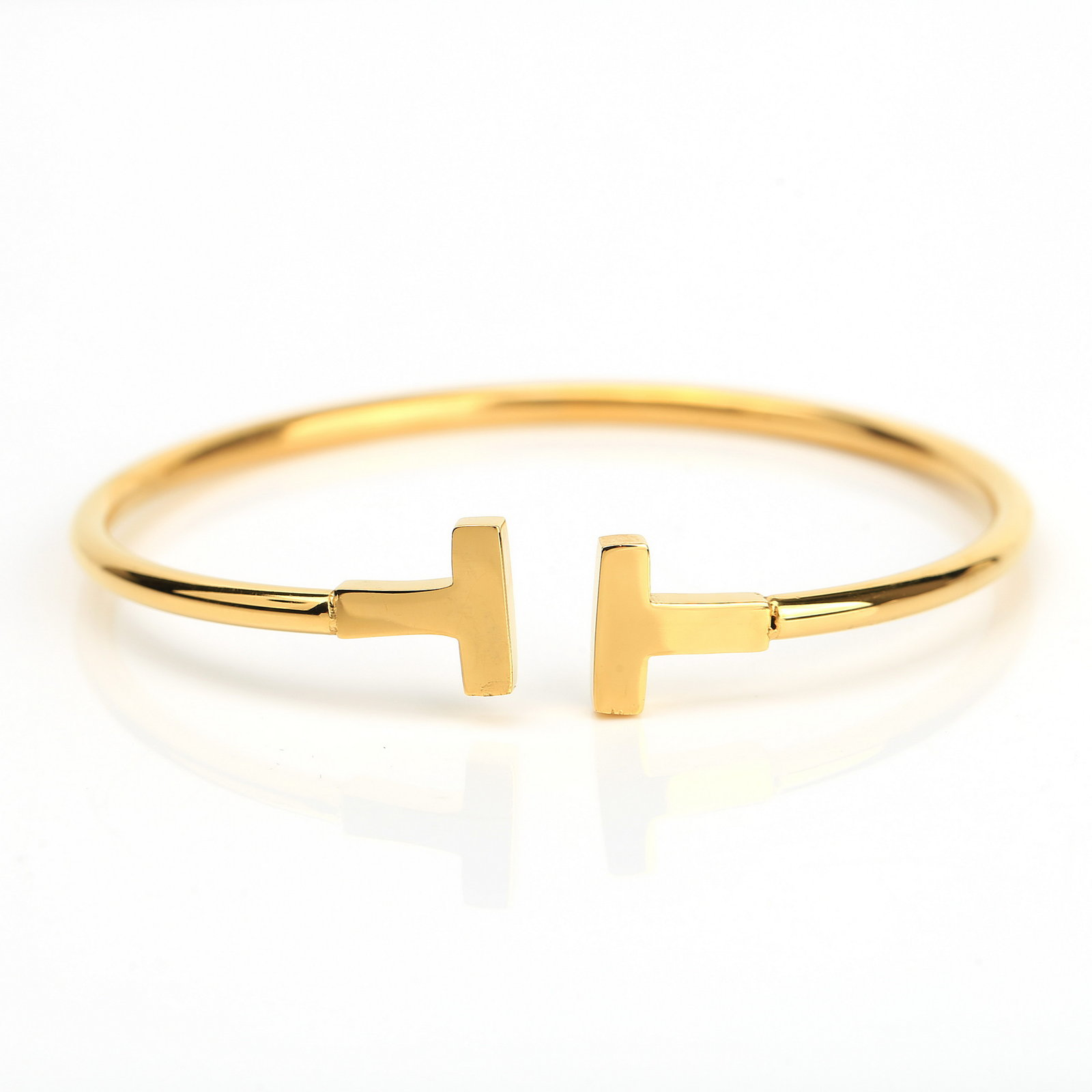 UE- Stylish Gold Tone Designer Bangle Bracelet With Contemporary T Bar Design