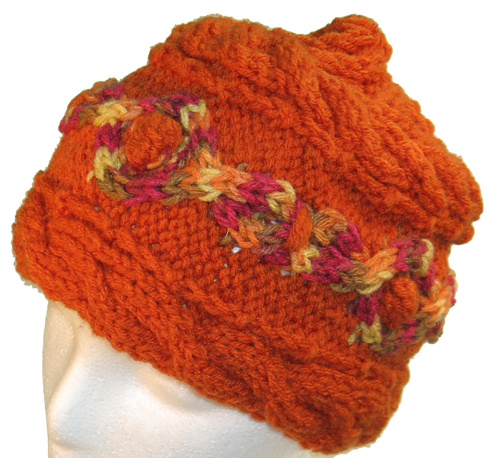 Primary image for Orange hand knit hat with multi-color cable