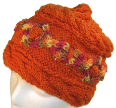 Orange hand knit hat with multi-color cable - $25.00