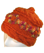 Orange hand knit hat with multi-color cable - $28.50