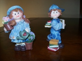 boy and girl statues - $6.00
