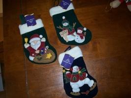 "set of three 7"" Christmas stockings - $3.00"