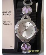 "New Women Watch, 1"" diameter - $5.00"