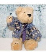 Vintage tan teddy bear wearing a light blue, navy, and tan sweater - $19.79
