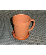 cup and saucer, decorative or useful for the gardener - $5.00