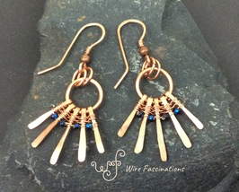 Handmade copper earrings: Wire wrapped spokes with dark blue glass beads - $30.00