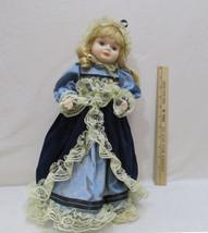Vintage Victorian Doll Blonde Porcelain Bisque Blue Velvet & Metal Stand... - $16.82