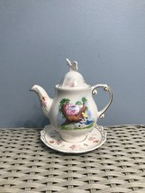 Disney Parks Alice in Wonderland Teapot and Saucer Made in Thailand - $25.00