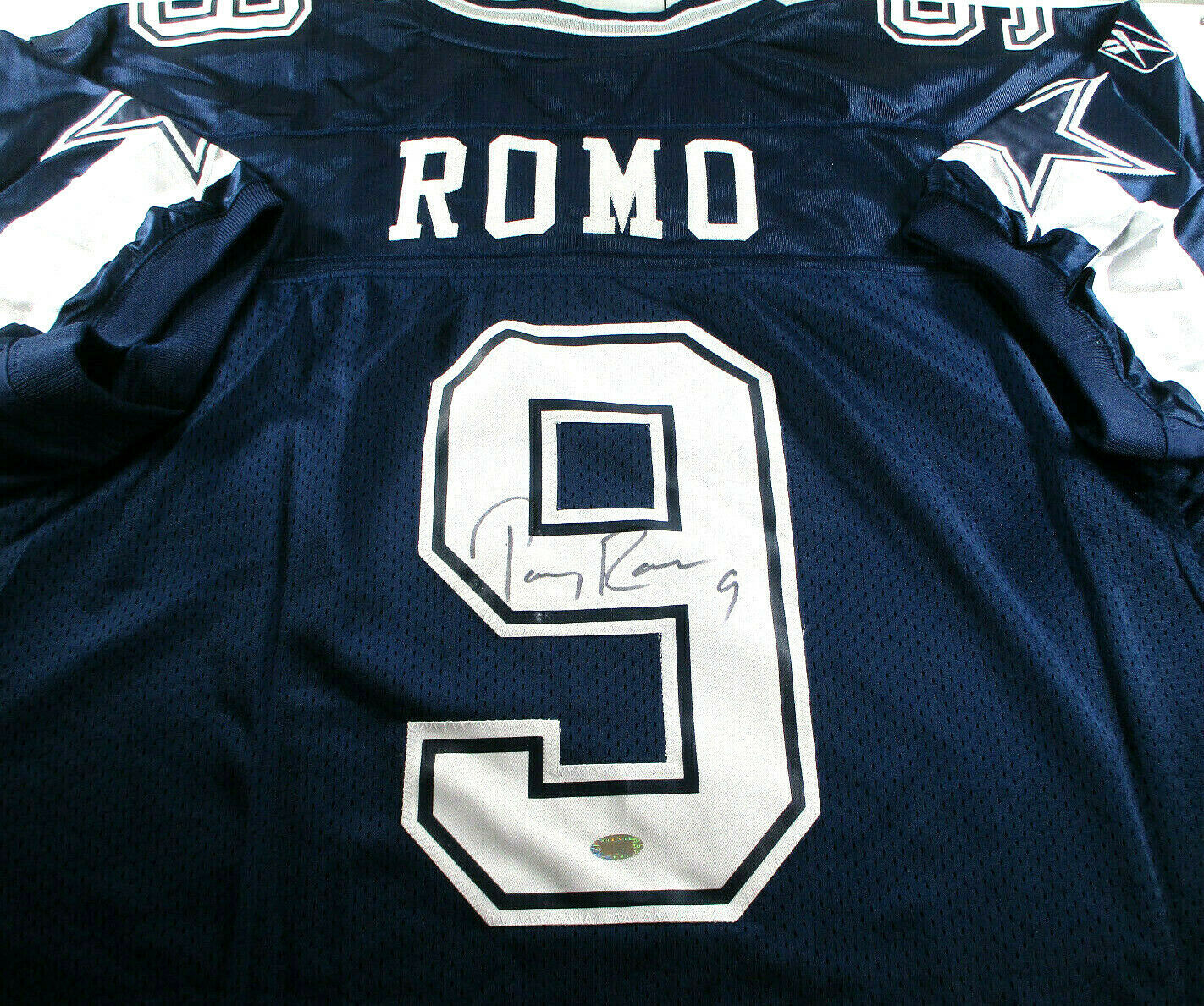 TONY ROMO / AUTOGRAPHED DALLAS COWBOYS BLUE REEBOK NFL FOOTBALL JERSEY / STEINER