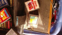 Atari 2600 Launch Edition Black with accessories and games. - $100.00