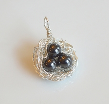 Sterling Silver Wire Wrapped Bird Nest Pendant with 3 Hematite Gemstone ... - $22.00