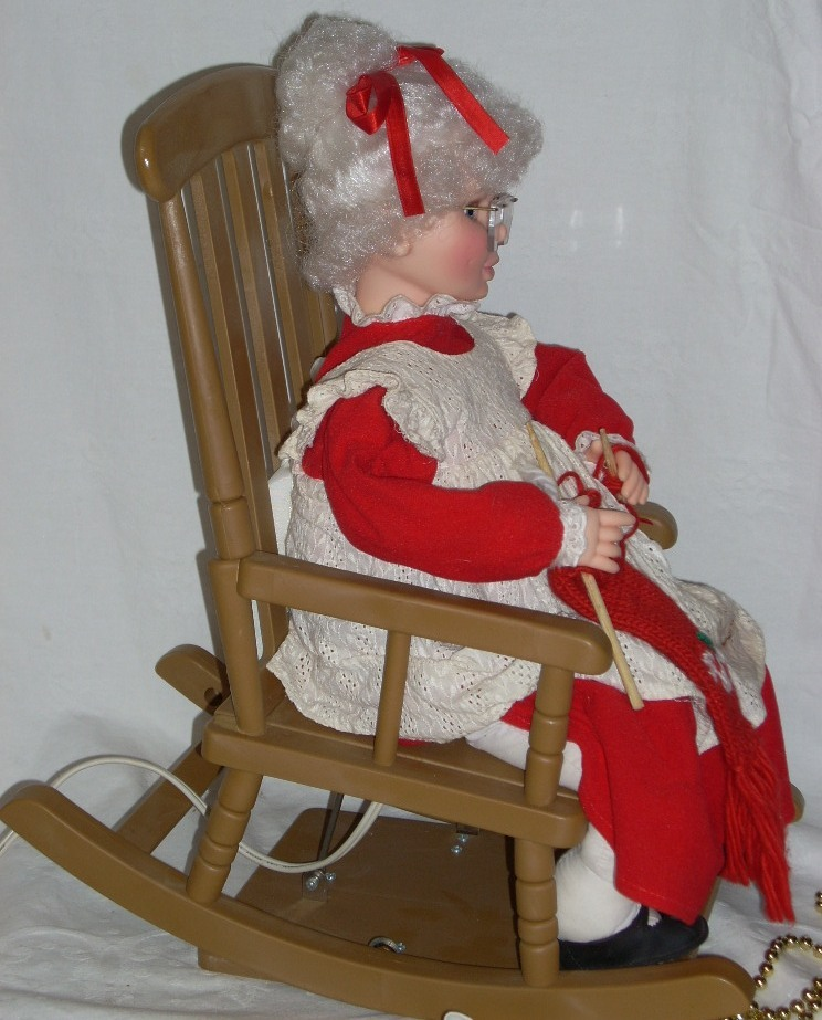Santas best animated mrs claus knitting in rocking chair