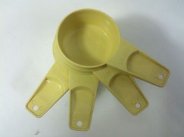 Tupperware Yellow Plastic 4 Set Measuring Cup - $17.64
