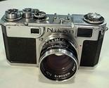 Nikon s2 black dial camer3 thumb155 crop