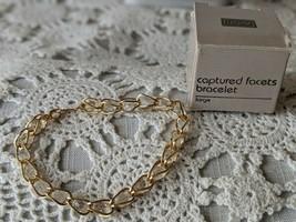 Avon Designer Signed Captured Faucets Bracelet  - $8.72