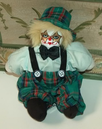 Clown with green plaid hat and pants