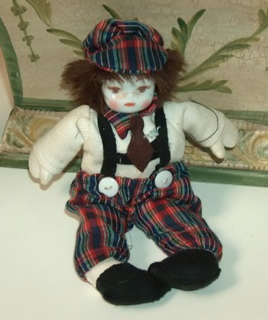 Clown with red plaid hat and pants