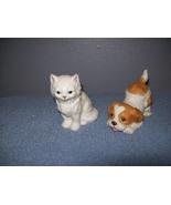 ceramic cat and dog statues - $1.00