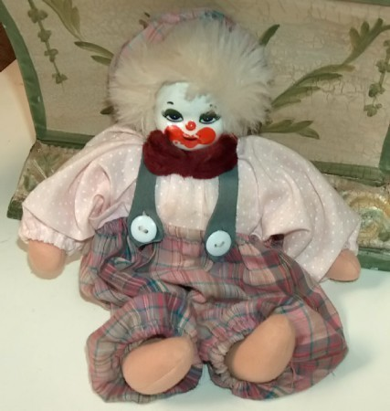 Clown with pink plaid pants and hat