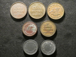 LOT OF 7 GAME AMUSEMENT TOKENS 5 TYPES INCLUDING RACE O RAMA FREE WOODEN... - $10.99